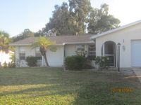 Florida Life on Golf Course minutes from beachs in this turn key furnished home!