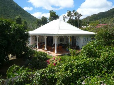 3-room apartment, in the middle of a Creole garden with pool, close to the sea