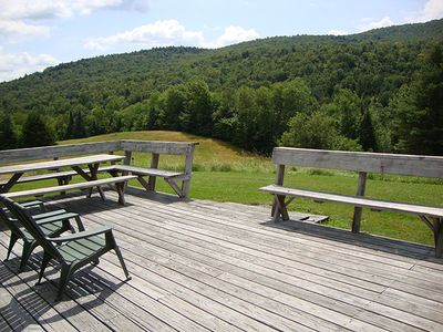 40' deck with built in benches and picnic table provides plenty of seating.