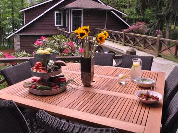 Poconos Pines / Lake Naomi cottage rental - Plenty of seating on the porch, plus deck leading to the garage and bonus room.