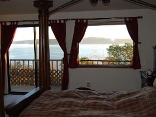 Camano Island house photo - Ocean View from Master Bedroom Suite with Sliding glass doors & deck