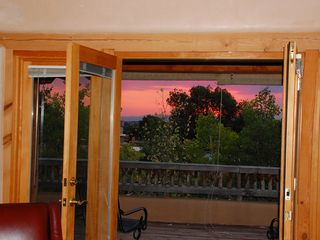Santa Fe house photo - sunset off upstairs patio