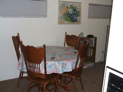Dining Table w/leaf  (seats 6).  Smaller table in kitchen (seats 2).