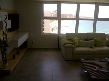 Living Room Area with 46in LCD TV and DVD player