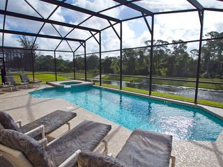 South facing pool with views over a lake and woodland conservation area - Emerald Island villa vacation rental photo