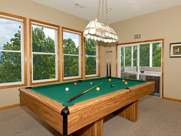 GAME ROOM WITH POOL TABLE, FOOSBALL, LARGE SCREEN TV AND SPA ON SCREEN PORCH