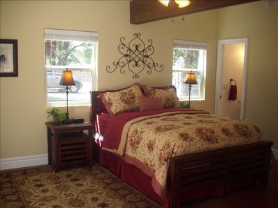Downstairs Back Bedroom w/ Queen Bed, Powder Room, Trees View & Twin Roll Away.