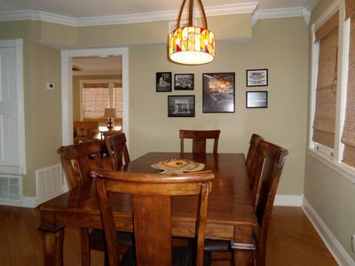 Dining room with 1960's old fishing photos from Chauncey Hinman