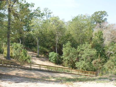 Milam lodge rental - Take the stairs or your 4-wheeler to the cove for swimming or pier fishing.