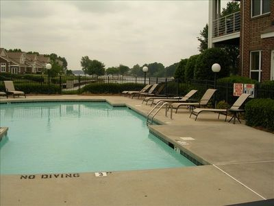 The swimming pool is adjacent to the building and also overlooks the lake.