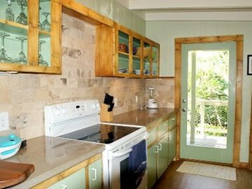 Kitchen with faux bamboo painted cabinet trim