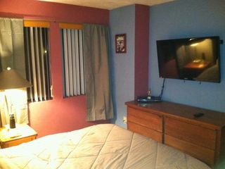 Bedroom with Plasma TV on the wall