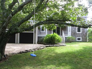 Wellfleet house photo - Lots of grass, two lower decks, and swings are great for kids of all ages.