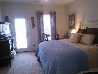 "Sunset Island Ocean City townhome photo - Captains Quarters 40"" TV Desk & Private Balcony with Sunset Views"
