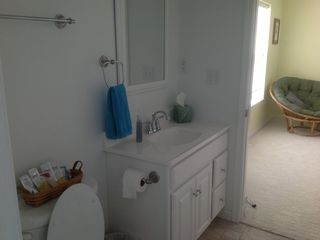 Second floor bathroom with full tub and shower