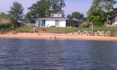 View of cottage and beach from the water while kayaking