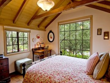 Bedroom 1 looks out over the oak trees