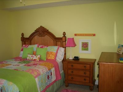 Guest room with a queen size bed and private bathroom, TV/ DVD.