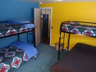 Bunk room w/ 1 double bed & 3 twin beds. Also board games, big closet & window.