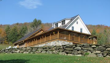 Amee Farm Lodge showcasing the wrap-around deck.
