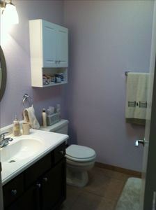 master bath with walk in shower.  Hand held hair dryer provided