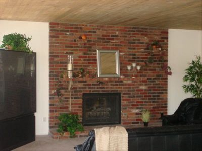 Living area with beautiful brick fireplace