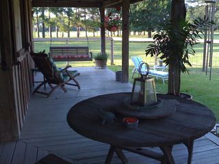 Breaux Bridge cottage photo - Relax and unwind on our wrap-a-round Porch.