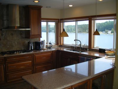 Remodeled kitchen, with all new appliances, looks out onto Filucy Bay.