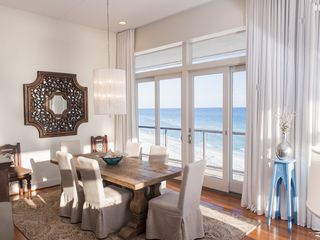 Inlet Beach house photo - Dining room. Notice 12' ceilings, linen curtains, Patio access, luxurious