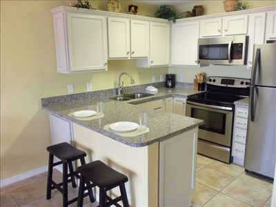 Remodeled Kitchen-New cabinets, Stainless steel appliances-Granite countertop.