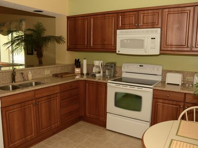 Our newly remodeled kitchen includes quartz countertops and walnut cabinets