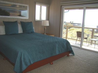 Second master bedroom upstairs with deck looking out to the ocean