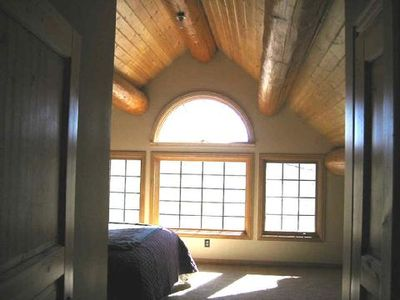 Master bedroom with private bath and vaulted ceiling.