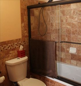 Bathroom #1, all new with Jacuzzi Tub/Shower Enclosure. All New Italian Tile!