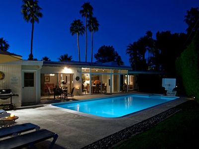 Palm Springs house rental - Dramatic Twilight View Of Private Saline Pool And Palm Trees.