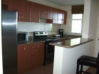 Loiza apartment photo - Kitchen w full-size fridge, micro oven, stove