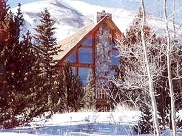 Breckenridge house rental - Two story views of majestic mountain peaks through the front window.