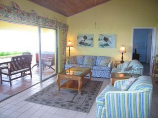 Spacious living room. 16 feet wide glass doors open unto the beach verandah. - Spanish Wells villa vacation rental photo
