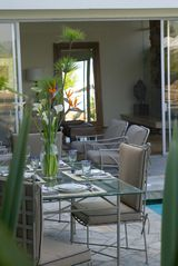 Hollywood estate photo - Peaceful poolside outdoor dining