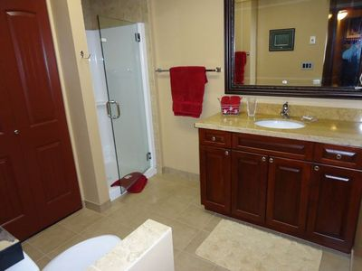 Second bathroom with stand up shower, and laundry behind doors