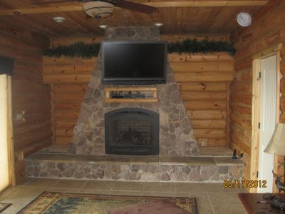Big Bay house rental - Lower level bedroom with gas fireplace.