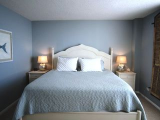 Wrightsville Beach condo photo - Oceanfront Master Suite with balcony access. Sleep to the sounds of the ocean!
