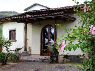Playa Hermosa house photo - Entrance with Mango trees and tropical flowers
