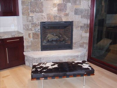 Gas fireplace with additional seating.