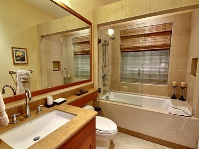 En suite bathroom of Second Master Suite: large soaking tub/shower combo.