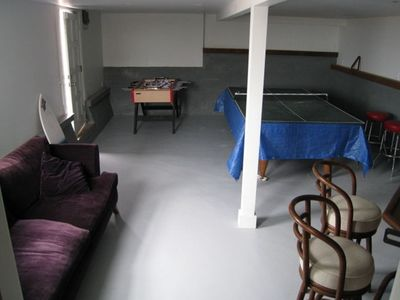 Game room in basement with pool table/ping pong and foos table