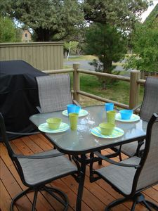 Outside dining area on oversized deck.