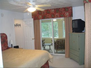 Moneta cottage photo - Master Bedroom with Slider to Sunporch and Private Bath