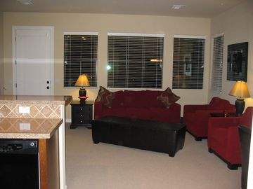 VIew from hallway at living room, queen sofa bed