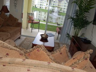 Cane Island condo photo - Condominium Living Room with View of Lake & Fountain - View 2